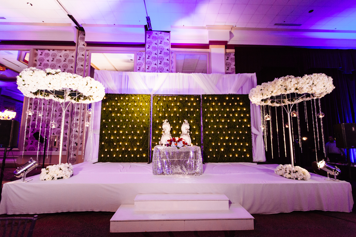 The sweetheart table at an Indian wedding reception. They reused the flower halos from the mandap.
