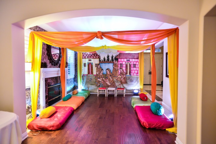 colorful sangeet pipe and drape decor at an Indian wedding