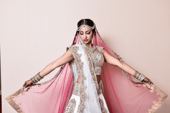 Indian bride wearing her white wedding lehenga