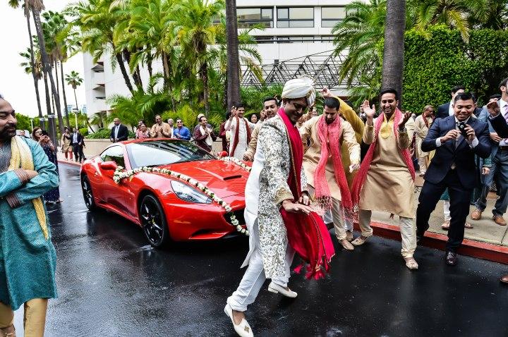 Neena-Chintan-Indian-wedding-venue-Hotel-Irvine-wedding-ceremony-groom-dancing-baraat-convertible