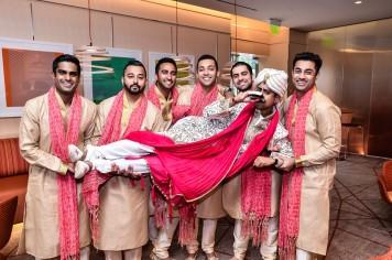 Neena-Chintan-Indian-wedding-venue-Hotel-Irvine-wedding-ceremony-groomsmen-carrying-groom
