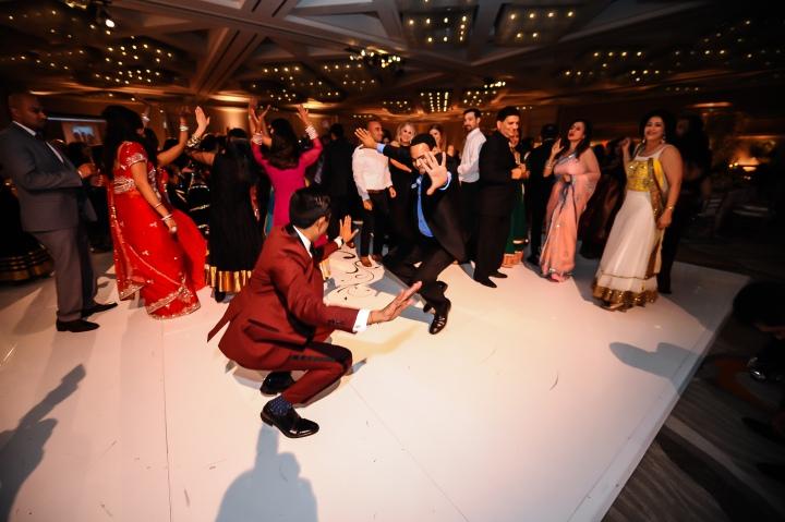 Neena-Chintan-Indian-wedding-venue-Hotel-Irvine-wedding-ceremony-Hindu-reception-groom-dancing