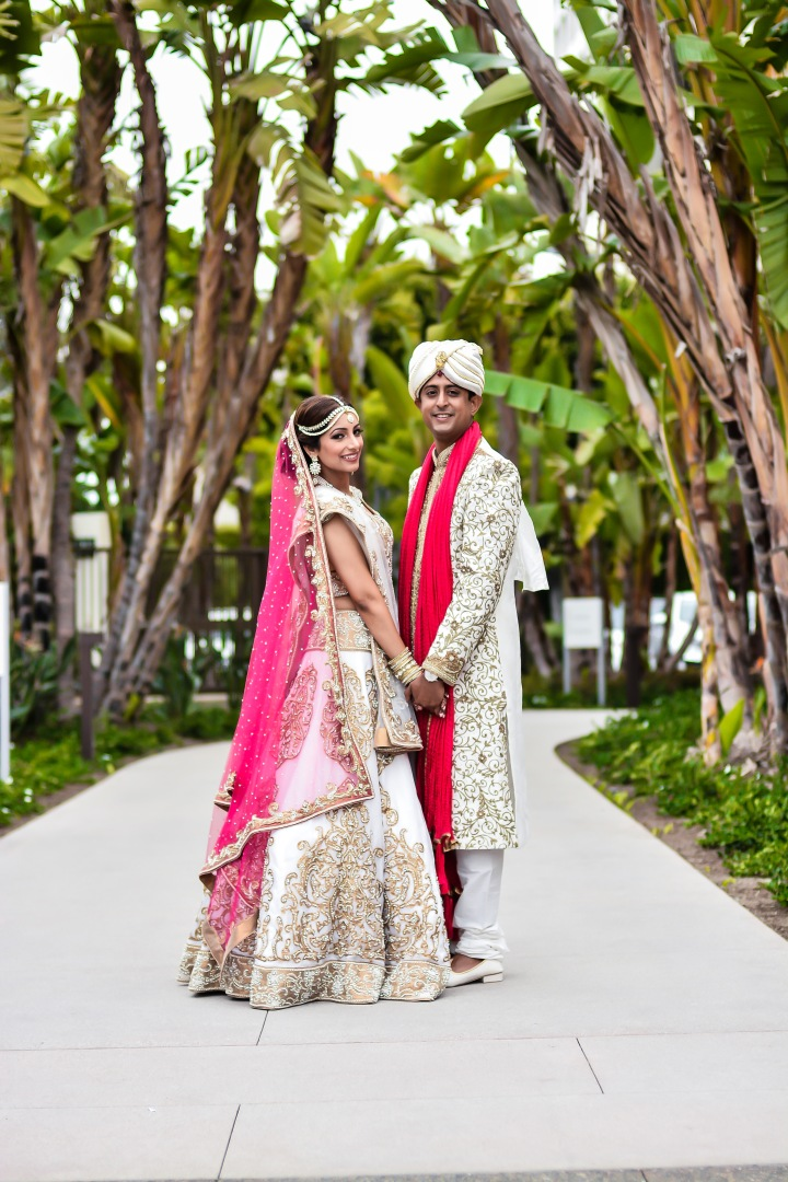Neena-Chintan-Indian-wedding-venue-Hotel-Irvine-wedding-ceremony-holding-hands-outside