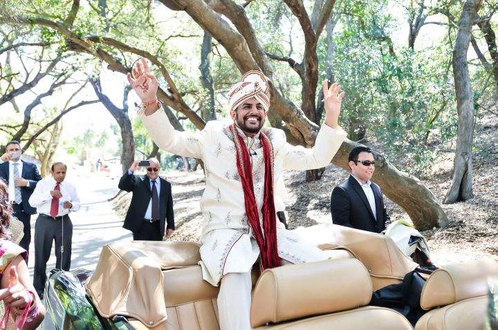 Indian groom riding in a Rolls Royce for his baraat in Malibu, CA