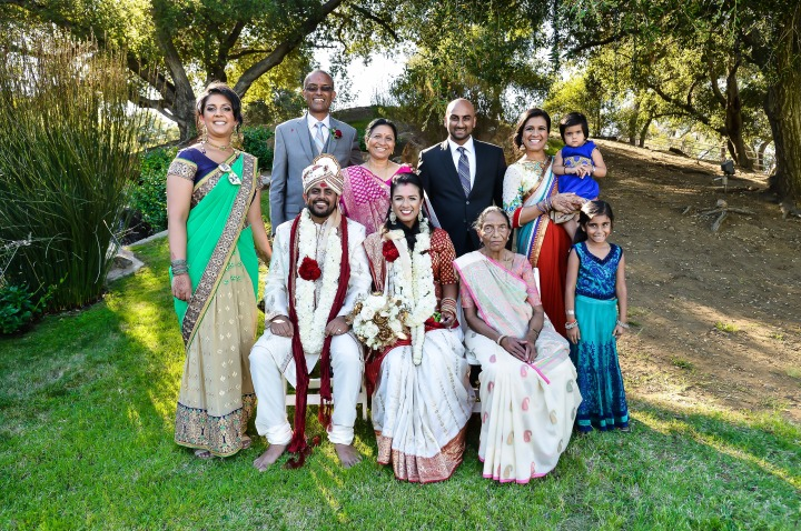 Indian bride and her family posing for a family photo