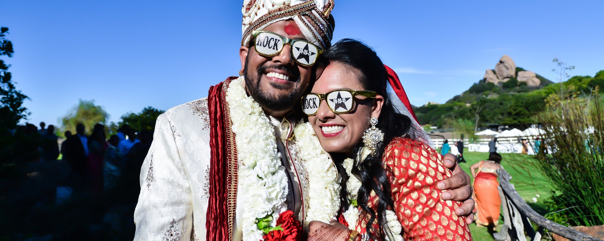 Indian Bride And Groom Wearing Funny Sunglasses Happily Posing For The Camera At Their Hindu