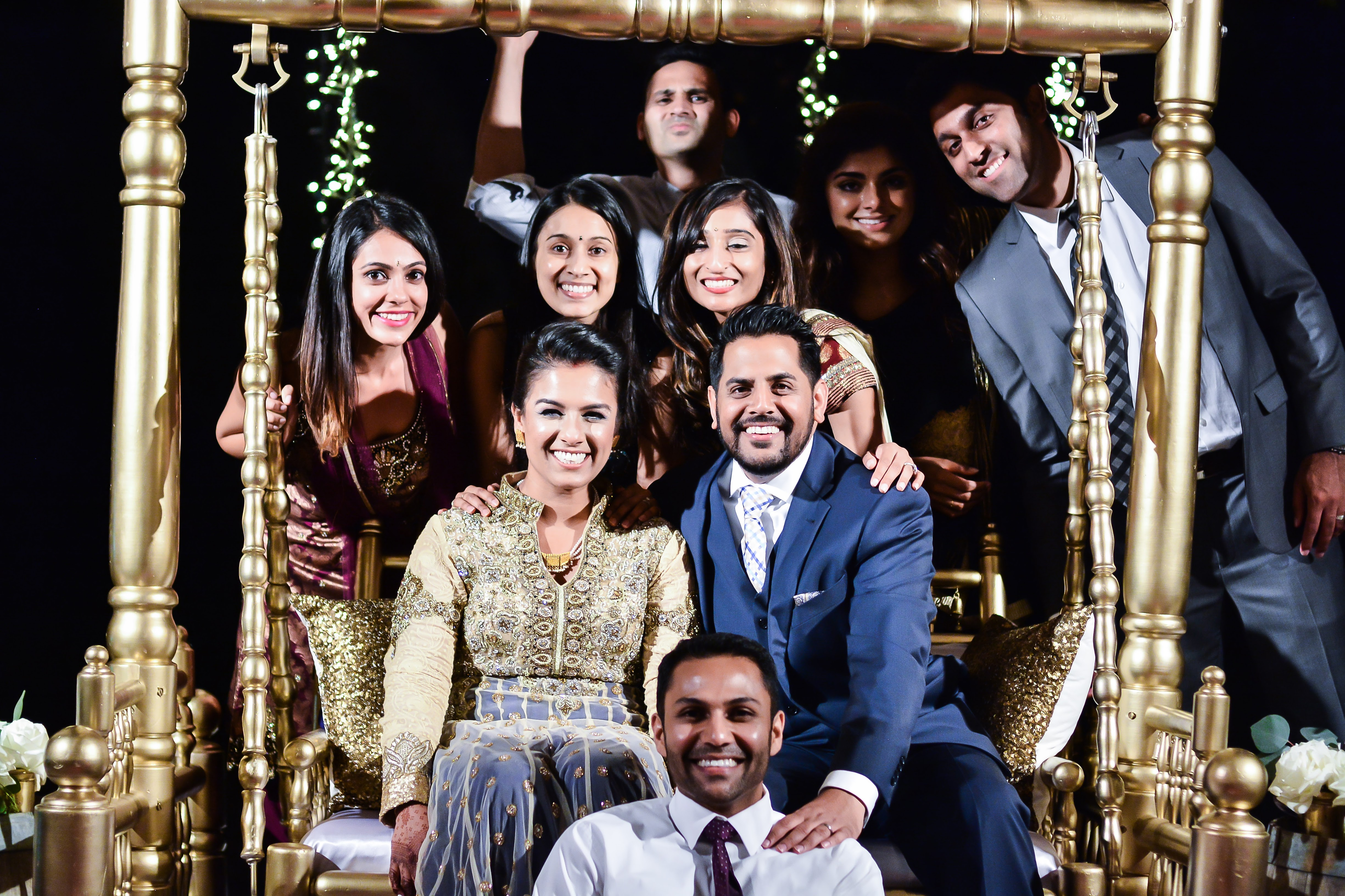 Bride And Grooms Friends Posing For A Photo At An Indian Wedding Reception