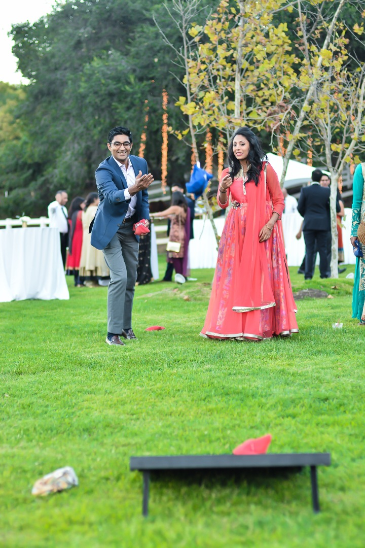 Guests At An Indian Wedding Playing Outdoor Games