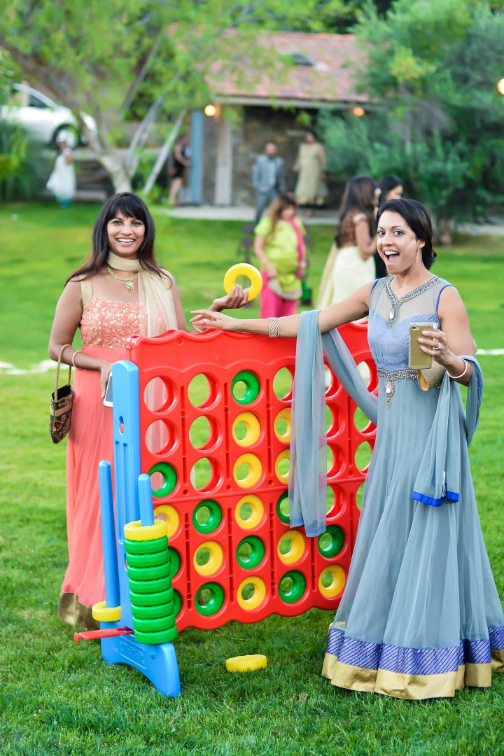 Guests at an Indian wedding playing Connect4