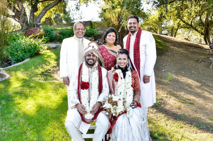 Indian groom and his family posing for a family photo