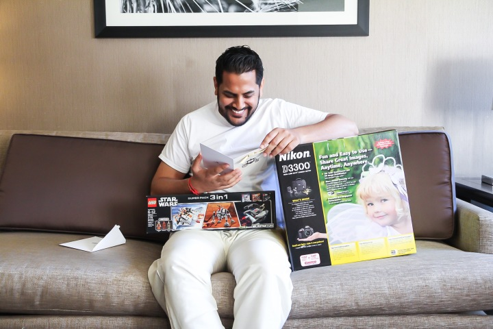Indian groom opening gifts from his bride before their wedding ceremony