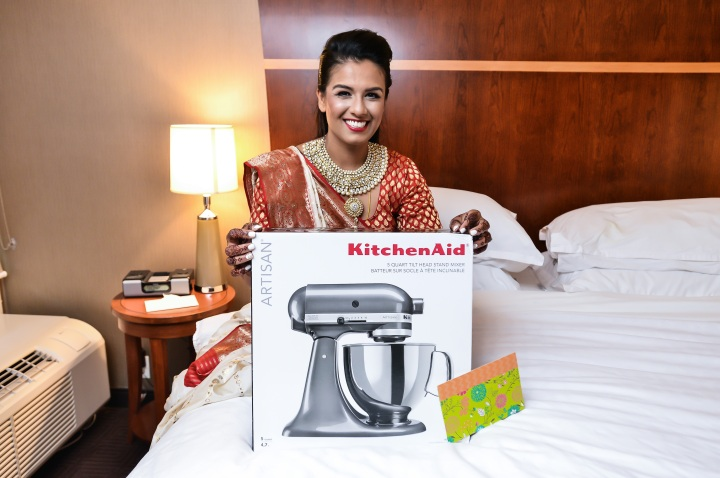 Indian bride holding her wedding gift: a KitchenAid mixer