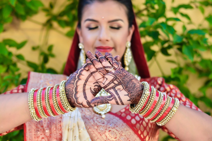 Indian bride with USC TRojan drawn into her mehndi on her hands