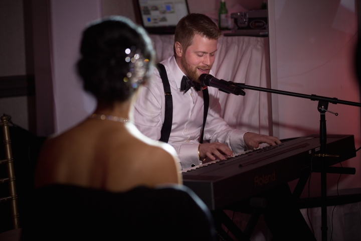 Canadian groom playing the piano and singing a Hindi film song to his bride