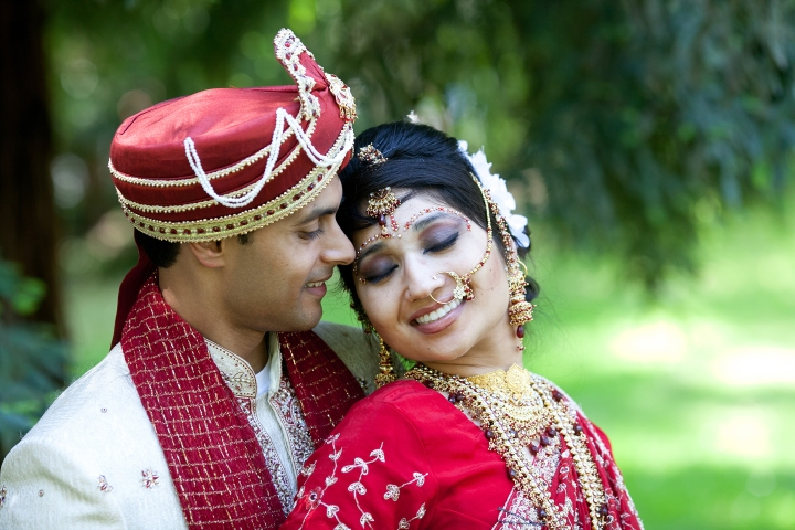 Indian bride and her husband in a romantic pose