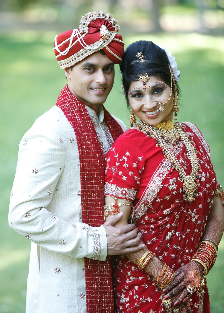 Indian bride and groom wearing their traditional Indian clothes at their wedding ceremony