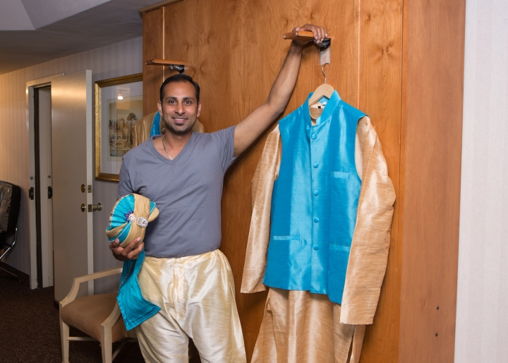 Ashmi-Suraj-Indian-wedding-venue-Hindu-Jain-ceremony-groom-sherwani-blue-turquoise