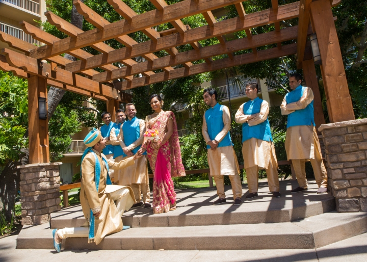 Ashmi-Suraj-Indian-wedding-venue-Hindu-Jain-ceremony-bride-groomsmen-groom-down-on-knee