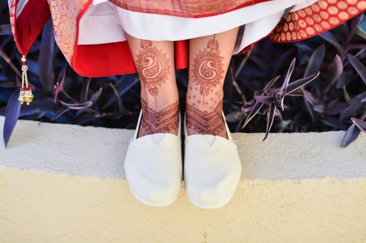 Indian bride's TOMS shoes and mehndi on her feet
