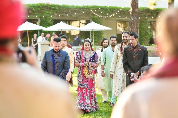 Sonia walks down the aisle with brothers