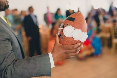 Garter belt toss at a Christian Indian wedding