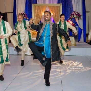 The groomsmen kept their kurtas on for the reception.